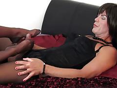 Tranny slut with big cock cums hard after foot job and wank