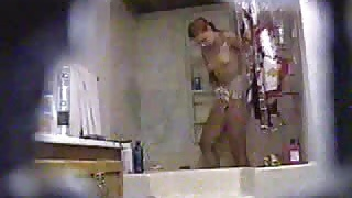 Hidden cam - girl taking a shower