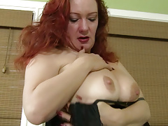Redhead milf Jessica O'Hare puts her sex toys to work