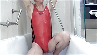 Andrea in red swimsuit